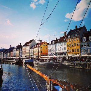 A picture of Nyhavn, an artificial canal with quaint colourful houses lining the waterfront