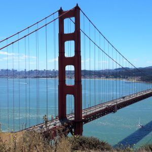A picture of the Golden Gate Bridge. San Francisco is in the background.